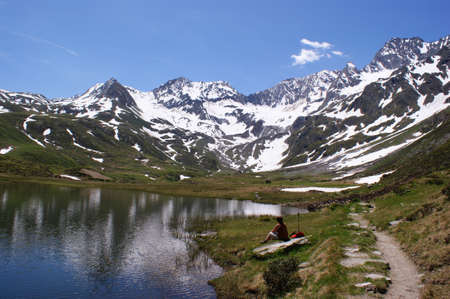 At a mountain lake in the Alps photo