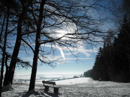 erzgebirge: Snowy Erzgebirge and blue sky with contrail