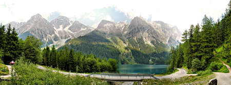 The Antholzer Lake is a mountain lake at the end of the Antholz valley in the Italian province of Alto Adige, near the border with Austria. He is surrounded by the mighty summits of the Rieserferner-Group. photo