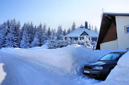erzgebirge: Parking in the Winter; acute parking shortage in the winter; great piles of snow; light and shadow Stock Photo