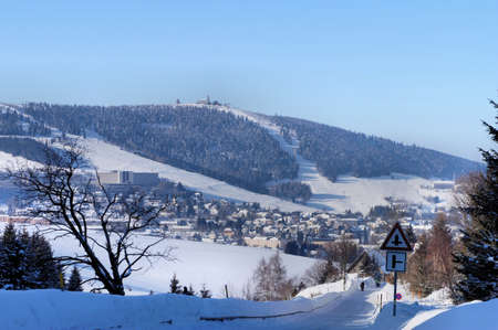 The deep snowy Erzgebirge in Saxonia, Germany viewed from the Czech Republic Stock Photo - 12540806