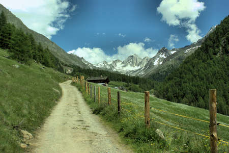 tyrol: The Merano High Mountain Trail around the Texel group in South Tyrol; blue sky and white clouds Stock Photo