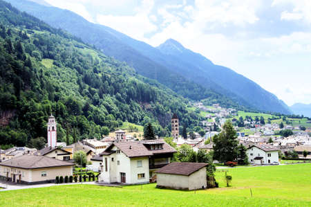 wooded: View on Poschiavo in Graubuenden; along the route of the Bernina Railway is the Poschiavo; municipality in the south of the Grisons, Switzerland;  surrounded by wooded mountains Stock Photo