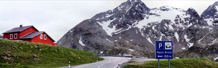 Bernina Pass, mountain pass road and snowfields, mostly cloudy; mountain world in Switzerland; panoramic image photo