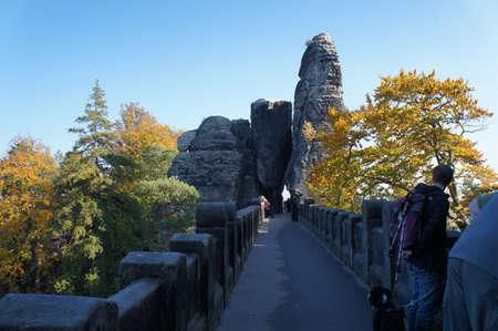 attraktion: The Bastei-Bridge in Saxon Switzerland; stone bridge between the bizarre rocks; tourist attraktion, sunny autumn day