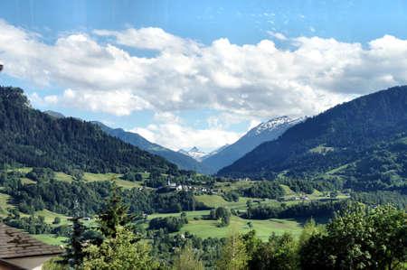 꼭대기가 눈으로 덮인: Landscape in Graubunden, Switzerland; valley of the Anterior Rhine and snow-capped mountains in the background 스톡 사진
