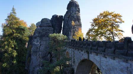 attraktion: View on the Bastei-Bridge in Saxon Switzerland in Germany; a sunny autumn day;