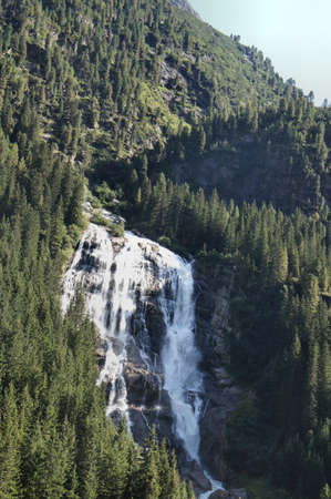 wooded: Waterfall at a steep mountain slope, wooded mountain