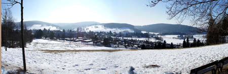 little town: Winter landscape in the Ore Mountains in Saxony, Germany, view on a little town, mountains and forests, blue sky, panorama