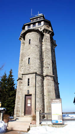 erzgebirge: Observation tower in the Erzgebirge in Germany, old tower, blue sky and snow Stock Photo