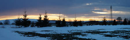 erzgebirge: Evening mood over the snowy Erzgebirge in Germany, snow-covered fields on a plateau, evening sky, panoramic
