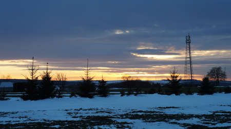 erzgebirge: Evening mood over the snowy Erzgebirge in Germany, snow-covered fields on a plateau, evening sky
