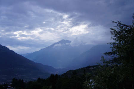 meran: Evening mood in the Adige Valley in South Tyrol, Italy; sky and clouds, mountains and valleys, villages in the Meran Country