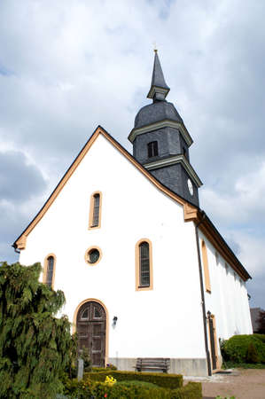 steeple: Little village church in Saxony in Germany steeple and slate roof cloudy sky Stock Photo