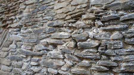 delineation: An old natural stone wall with large and small stones Stock Photo