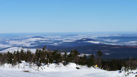 erzgebirge: On the Fichtelberg in the Ore Mountains in Saxony, Germany in winter, views on the mountains and Phlberg Brenstein, endless widths and forests