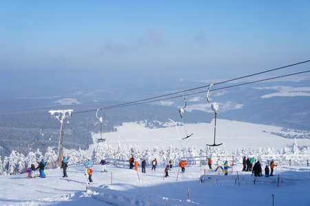 erzgebirge: Sportsmen winter sports area on the Fichtelberg in the Ore Mountains in Saxony, Germany, a chairlift, winter, snow-capped landscape, view to Bohemia in the Czech Republic, blue sky
