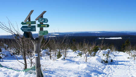 erzgebirge: Signposts on the Fichtelberg in the Ore Mountains in Saxony, Germany, endless widths and forests, on the western Ore Mountains views