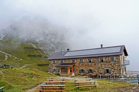 lodge: A mountain lodge in the Stubai Alps in Tyrol, Austria, dense fog in the mountains