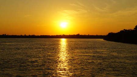upstream: Sunset over the Zambezi River in Zambia