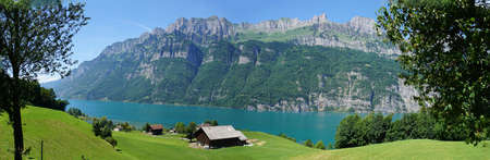 The Lake Walensee and a part of the mountain chain of the Churfirsten, landscape in the canton of St. Gallen in Switzerland, panoramic