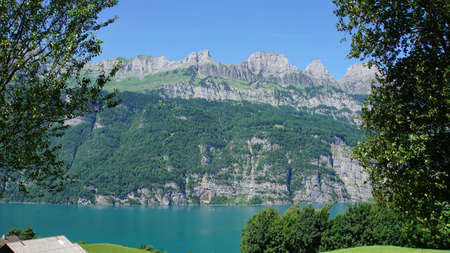 The mountain chain Churfirsten in Switzerland and a part of the lake Walensee, steep rocks and turquoise-colored water