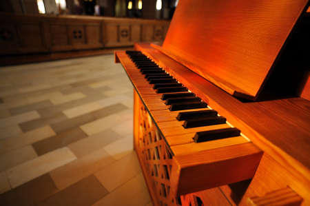 Upright piano inside the church. Upright piano inside of St Elisabeth catholic church from city of Darmstadt, Germany.
