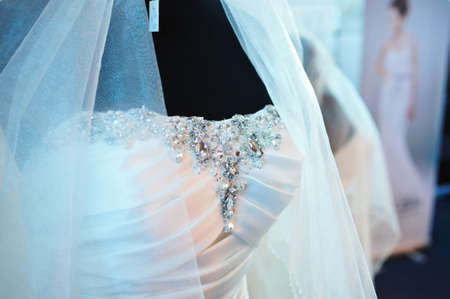 Wedding dress. Beautiful wedding dress for bride in the showroom. Stock Photo