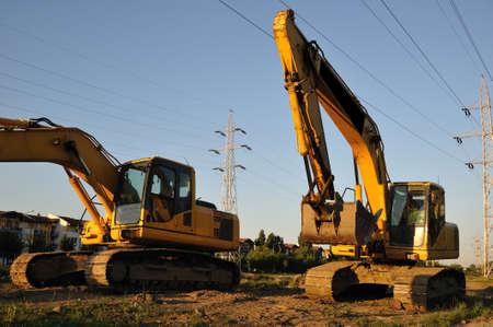 Tracked excavators. Big tracked excavators on the construction site.