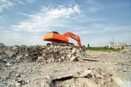 Demolition construction site in daytime. Crawler excavator working on demolition site in daytime. 写真素材
