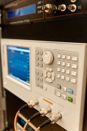 Electronic oscilloscope. Measuring the electric signal with electronic oscilloscope in research laboratory.