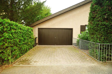 Superior House Garage For Vehicles. Private Garage Near The House With Automatic  Doors And Paved Alley