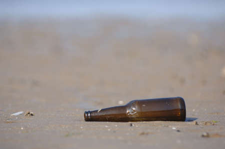 Bottle lying on a deserted beach photo