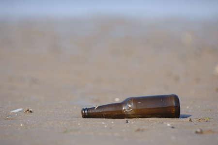 corked: Bottle lying on a deserted beach