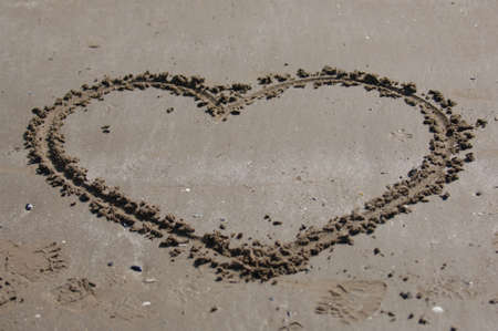 U message in the sand with heart Stock Photo - 3534683