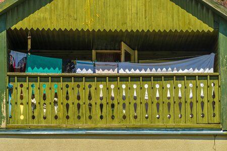 Green painted summer balcony Фото со стока