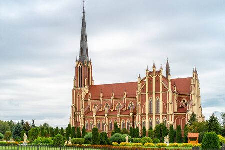 Beautiful neo-gothic catholic church of Holy Trinity in autumn in Gerviaty village, Belarus. It is the largest church in Belarus now