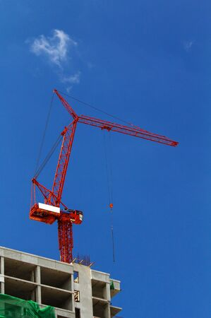 Red crane on blue sky photo