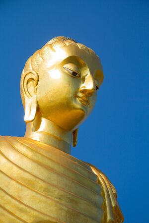 The golden buddha in blue sky  photo