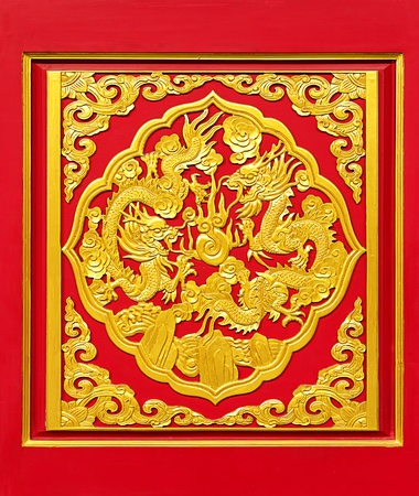 Gold dragon on red wall photo