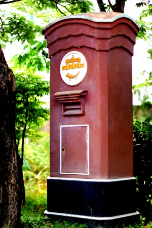 Traditional red postbox in Thailand  photo