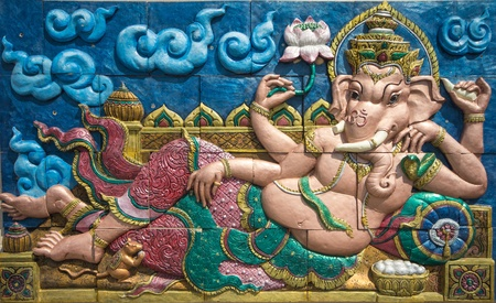 a righteous person: Ganesha concrete stucco on the wall Stock Photo