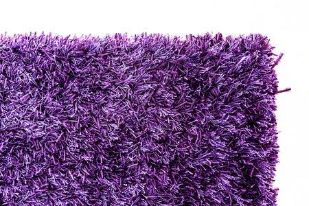 Texture of a purple carpet corner  photo