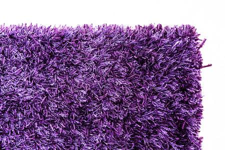 purple carpet texture. texture of a purple carpet corner photo