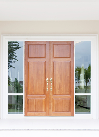 Double wooden doors with glass and frame photo