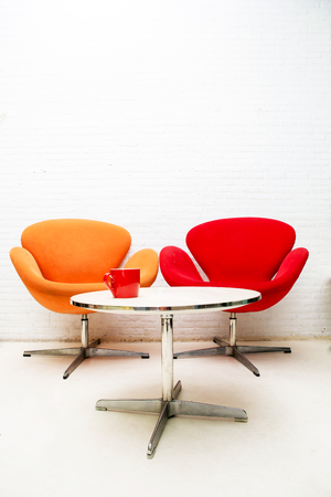 Modern interior table with coffee cup and two chairs  photo