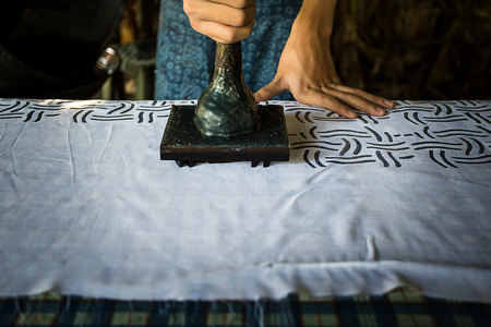 screen printing: Fabric Printing With the press of a pattern by the manual.Use wax to prevent the fabric is patterned color.The traditional way of thailand. Stock Photo