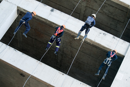 rappelling: Firefighters practice rappelling on tower. on November 01, 2009 in Talingchan, Bangkok, Thailand.
