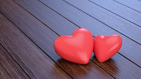 Two hearts on wooden floor