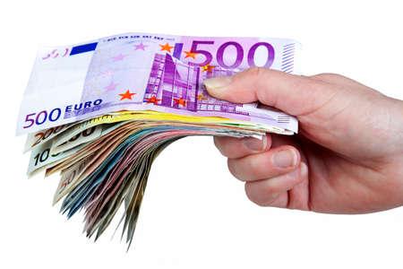 Hand holding paper money